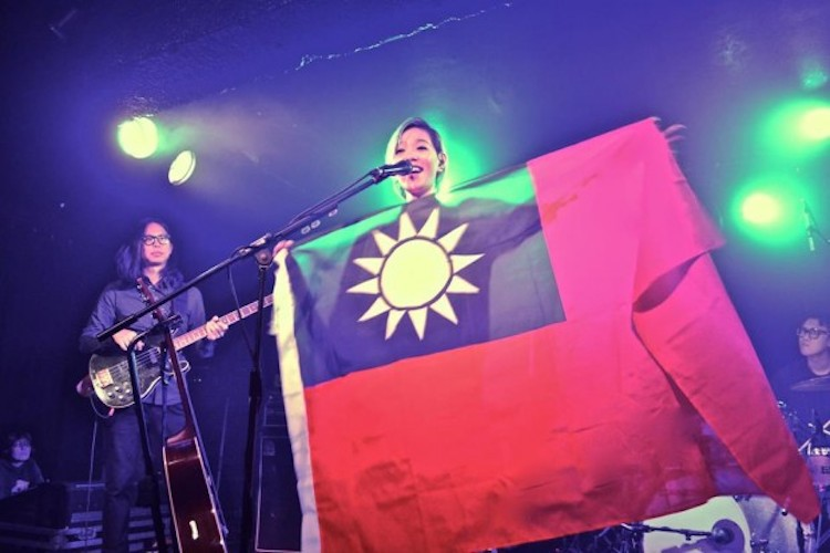 Popstar's China tour cancelled after she displays Taiwanese flag at UK gig