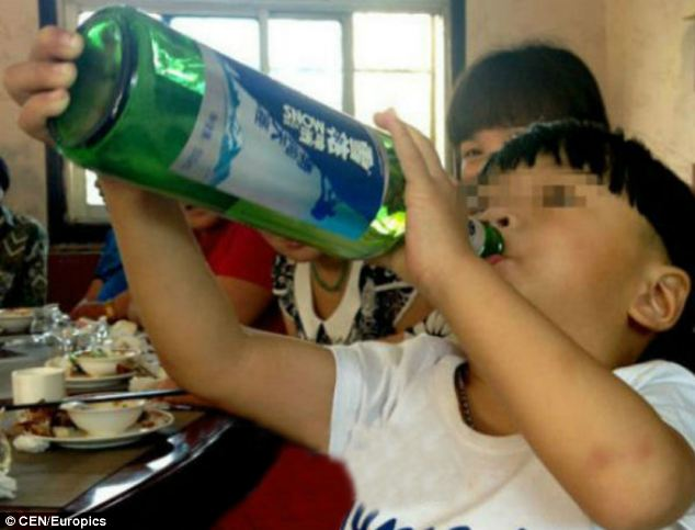 WATCH: Alcoholic Chinese two-year-old who downs bottles of wine and beer