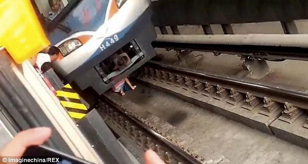 WATCH: Pregnant woman falls under subway train