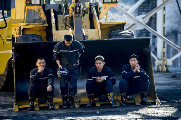 Tense wait to save 17 Chinese coal miners buried after gas blast