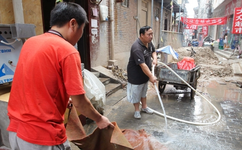 Following the worst drought in 15 years, Beijing residents sink wells and siphon water