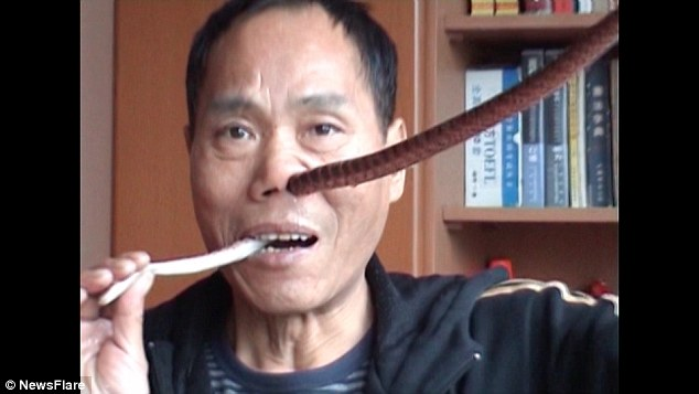 WATCH: Sichuan's 'Snake King' swallows live snakes whole, pulls them up nose