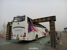 Dozens injured after bus driver blinded by smog drives straight into height clearance barrier