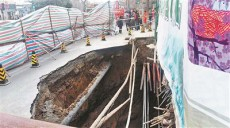 Beijing street caves in three times in 10 hours, swallowing multiple homes