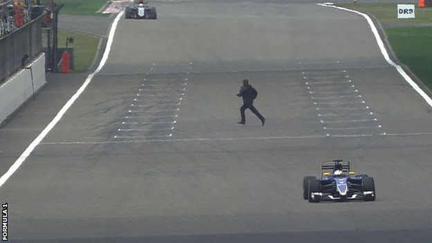F1 fan runs onto track at Shanghai Grand Prix 'to try a car'