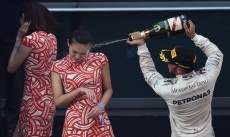 At Shanghai Grand Prix, grid girl gets champagne face shot care of Lewis Hamilton
