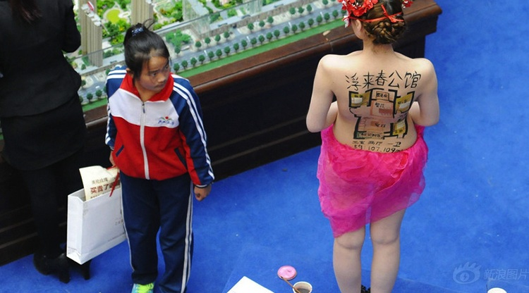 The new normal in real estate: nude models with floor plans painted onto their backs